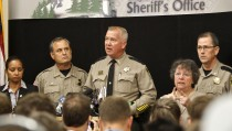 Douglas County Sheriff John Hanlin (C) speaks at a news conference in Roseburg, Oregon October 2, 2015. Chris Harper-Mercer, the man killed by police on Thursday after he fatally shot nine people at the southern Oregon community college was a shy, awkward 26-year-old fascinated with shootings, according to neighbors, a person who knew him, news reports and his own social media postings.  REUTERS/Steve Dipaola - RTS2T5X