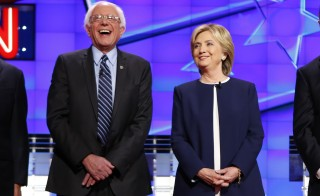 U.S. Democratic presidential candidates Senator Bernie Sanders and former Secretary of State Hillary Clinton laugh together before the start of the first official Democratic candidates debate of the 2016 presidential campaign in Las Vegas, Nevada October 13, 2015.  Photo by REUTERS/Mike Blake