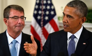 U.S. Defense Ash Carter (L) listens as President  Barack Obama (R) announces plans to slow the withdrawal of U.S. troops from Afghanistan,  in the Roosevelt Room at the White House in Washington October 15, 2015. The plan would keep the current force of 9,800 through most of 2016 before beginning to trim levels. REUTERS/Jonathan Ernst - RTS4MBW
