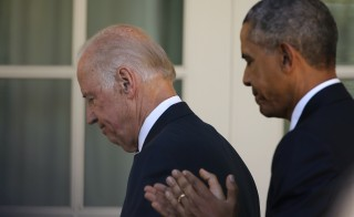 U.S. Vice President Joe Biden (L) and President Barack Obama walk back to the Oval Office after Biden announced he will not seek the 2016 Democratic presidential nomination, during an appearance in the Rose Garden of the White House in Washington October 21, 2015. REUTERS/Carlos Barria