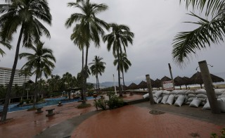 A view of a deserted hotel in Puerto Vallarta, Mexico, equipped with sandbag reinforcements after tourists were evacuated prior to Hurricane Patricia's landfall Friday evening. Photo by Henry Romero/Reuters