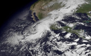 Hurricane Patricia, a category 5 storm, is seen approaching the coast of Mexico in a NOAA satellite image taken by GOES East at 10:45 ET (14:45 GMT) October 23, 2015. Patricia, one of the strongest storms ever recorded, bore down on Mexico's Pacific Coast, prompting the evacuation of thousands of tourists and residents and a mad rush for emergency supplies. The U.S. National Hurricane Center reported on Friday morning Patricia had maximum sustained winds of about 200 miles per hour (321 km per hour) as it moved north at 10 mph (16 kph).   REUTERS/NOAA/Handout via Reuters  THIS IMAGE HAS BEEN SUPPLIED BY A THIRD PARTY. IT IS DISTRIBUTED, EXACTLY AS RECEIVED BY REUTERS, AS A SERVICE TO CLIENTS. FOR EDITORIAL USE ONLY. NOT FOR SALE FOR MARKETING OR ADVERTISING CAMPAIGNS - RTS5VCC