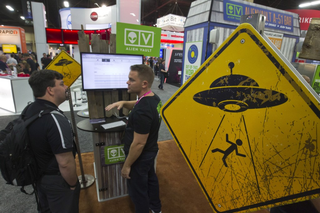 Alien abduction warning signs are posted in the AlienVault booth during the Black Hat USA 2015 cybersecurity conference in Las Vegas. Photo by Steve Marcus/Reuters