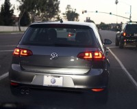 A new diesel Volkswagen Golf TDI drives in Huntington Beach, California, United States, September 19, 2015. Volkswagen shares plunged more than 20 percent on Monday, their biggest one-day fall, after the German carmaker admitted it had rigged emissions tests in the United States, and U.S. authorities said they would widen their probe to other manufacturers. Germany, alarmed at the potential damage the scandal could inflict on its world-beating car industry, urged Volkswagen to fully clear up the matter and said it would investigate whether emissions data had also been falsified in Europe. The U.S. Environmental Protection Agency (EPA) said on Friday Europe's biggest carmaker had used software for diesel VW and Audi branded cars that deceived regulators measuring toxic emissions and could face penalties of up to $18 billion. Picture taken September 19, 2015. REUTERS/Lucy Nicholson - RTX1RQTO