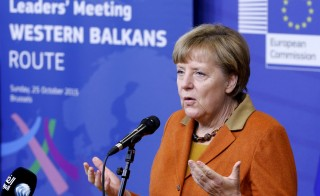 Germany's Chancellor Angela Merkel talks to the media as she arrives at a meeting over the Balkan refugee crisis with leaders from central and eastern Europe at the EU Commission headquarters in Brussels, Belgium, October 25, 2015.      REUTERS/Francois Lenoir     - RTX1T5Q3
