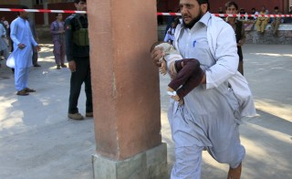 A rescue worker carries a child, who was injured during an earthquake, at a hospital in Jalalabad, Afghanistan on Oct. 26. The 7.5-magnitude earthquake struck a remote area of northeastern Afghanistan on Monday, shaking the capital Kabul, and reaching as far as northern India and Pakistan. Photo by Parwiz/Reuters