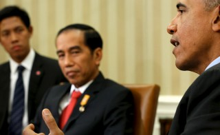 President Barack Obama (right) delivers remarks after meeting with Indonesia's President Joko Widodo (center) in the Oval Office at the White House in Washington, D.C., on Oct. 26. Widodo cut short his visit to deal with a forest fire emergency. Photo by Jonathan Ernst/Reuters