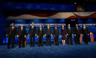 Republican U.S. presidential candidates (left to right) Gov. John Kasich, former Gov. Mike Huckabee, former Governor Jeb Bush, Sen. Marco Rubio, businessman Donald Trump, Dr. Ben Carson, former HP CEO Carly Fiorina, Sen. Ted Cruz, Gov. Chris Christie and Rep. Rand Paul pose before the start of the 2016 U.S. Republican presidential candidates debate held by CNBC in Boulder, Colorado, October 28, 2015. Photo by Rick Wilking/Reuters