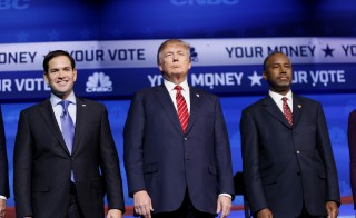 Sen. Marco Rubio, left, represented the Republican Party's establishment, while businessman Donald Trump, center, and Dr. Ben Carson continue to play the part of the Washington outsiders. Photo by Rick Wilking/Reuters