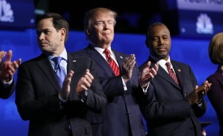 Republican U.S. presidential candidates (L-R) U.S. Senator Marco Rubio, businessman Donald Trump and Dr. Ben Carson applaud before the start of the 2016 U.S. Republican presidential candidates debate held by CNBC in Boulder, Colorado, October 28, 2015. REUTERS/Rick Wilking - RTX1TPVF