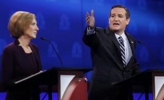 Republican U.S. presidential candidate U.S. Senator Ted Cruz speaks as former HP CEO Carly Fiorina looks on at the 2016 U.S. Republican presidential candidates debate held by CNBC in Boulder, Colorado, October 28, 2015. REUTERS/Rick Wilking  - RTX1TQ2W