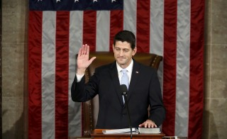 Newly elected Speaker of the U.S. House of Representatives Paul Ryan is sworn in to succeed outgoing Speaker John Boehner on Capitol Hill in Washington October 29, 2015. REUTERS/Gary Cameron       TPX IMAGES OF THE DAY      - RTX1TV3E