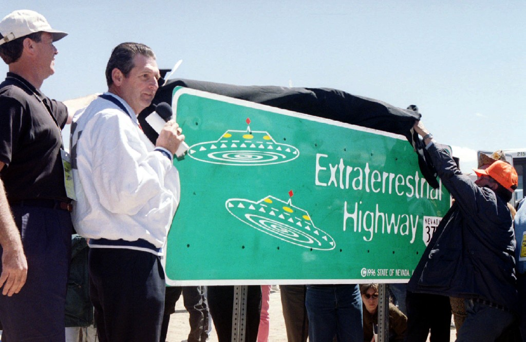 Nevada Governor Bob Miller presides over the unveiling of a new road sign for Nevada State Highway 375 on April 18, 1996, about 150 miles north of Las Vegas. The highway has been the location for numerous UFO sightings, possibly related to the close proximity of the secret U.S. airbase Area 51. Photo by Reuters