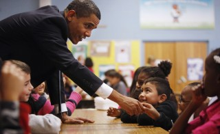 U.S. President Barack Obama greets third and fourth grade students at Viers Mill Elementary School in Silver Spring, Maryland, October 19, 2009. Obama visited the school where the students had improved their standardized test scores.  REUTERS/Jason Reed   (UNITED STATES EDUCATION POLITICS) - RTXPSK1