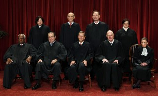 The justices of the U.S. Supreme Court gather for a group portrait in the East Conference Room at the Supreme Court Building in Washington, October 8, 2010. Seated from left to right in front row are: Associate Justice Clarence Thomas, Associate Justice Antonin Scalia, Chief Justice John G. Roberts, Associate Justice Anthony M. Kennedy, Associate Justice Ruth Bader Ginsburg. Standing from left to right in back row are: Associate Justice Sonia Sotomayor, Associate Justice Stephen Breyer, Associate Justice Samuel Alito Jr., and Associate Justice Elena Kagan.      REUTERS/Larry Downing (UNITED STATES - Tags: POLITICS CRIME LAW) - RTXT6Z3