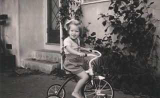 Sally Ride on a tricycle. Courtesy of Tam O'Shaughnessy/Ride Family/MacMillan Children's Publishing Group