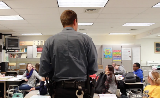 School resource officer Justin Schlottman catches up with students at Cedar Crest High School.