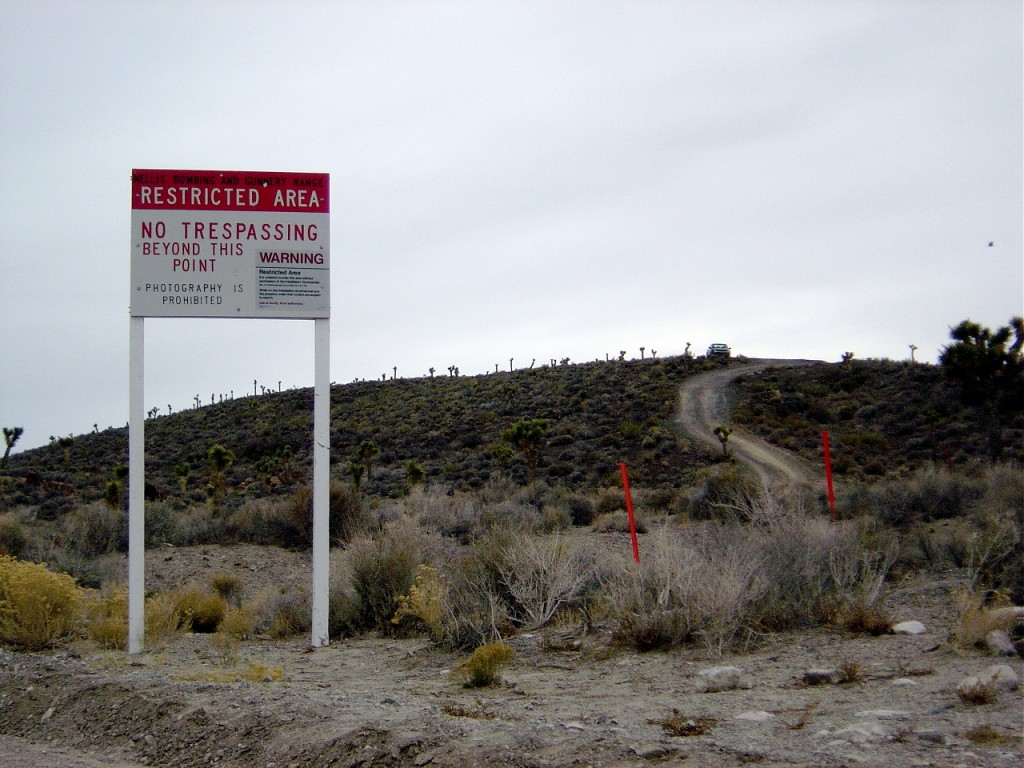 "Area 51 border and warning sign stating that ""photography is prohibited."" Photo by Flickr user X 51"