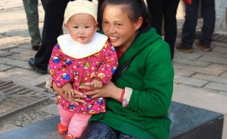 A mother and child visit Tongli, a preserved ancient village in eastern China, in November 2014. Photo by Larisa Epatko/PBS NewsHour