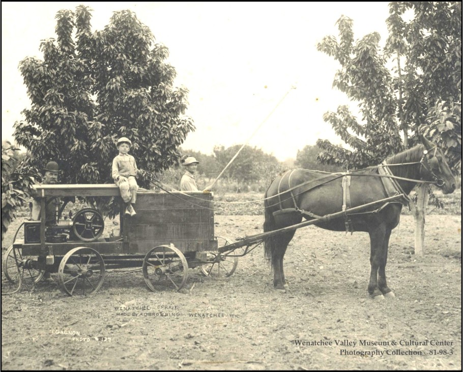 A Wenatchee Sprayer made by A. D. Browning, Wenatchee. Two men, one with bamboo spray pole, and one small boy sitting on top of sprayer pulled by one horse in a fruit orchard in Wenatchee. Because farmers did not know of the potential toxicity or longevity of pesticides in use at the time, Washington law exempts farmers from being liable for contamination from legally applied pesticides. Photo courtesy of T. Gagnon/Wenatchee Valley Museum & Cultural Center