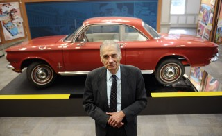"Consumer advocate Ralph Nader poses in front of a Chevrolet Corvair in The American Museum of Tort Law, Friday, Sept. 25, 2015, in Winsted, Conn. The museum, which opens Saturday, has been developed by the consumer advocate and two-time presidential candidate as a kind of ode to the jury system. Nader featured the Corvair in his 1965 book on the auto industry's safety record, ""Unsafe at Any Speed"". (AP Photo/Jessica Hill)"