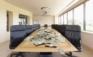 Pile of dollars on conference table