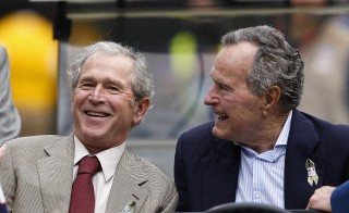 HOUSTON, TX - NOVEMBER 17:  President George W. Bush, left, and President George H.W. Bush at Reliant Stadium before the Oakland Raiders play the Houston Texans on November 17, 2013 in Houston, Texas.  (Photo by Bob Levey/Getty Images)