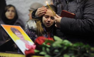 A girl cries during a funeral service for Nina Lushchenko, 60, a victim of the Russian MetroJet Airbus A321 crash, at a church in Veliky Novgorod on November 5, 2015 ahead of her burial. Russian airline Kogalymavia's flight 9268 crashed en route from Sharm el-Sheikh to Saint Petersburg on October 31, killing all 224 people on board, the vast majority of them Russian tourists. AFP PHOTO / OLGA MALTSEVA        (Photo credit should read OLGA MALTSEVA/AFP/Getty Images)