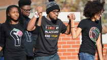 COLUMBIA, MO - NOVEMBER 9: Jonathan Butler, a University of Missouri grad student who did a 7 day hunger strike is greeted by the crowd of students on the campus of University of Missouri - Columbia on November 9, 2015 in Columbia, Missouri. Students celebrate the resignation of University of Missouri System President Tim Wolfe amid allegations of racism. (Photo by Michael B. Thomas/Getty Images)