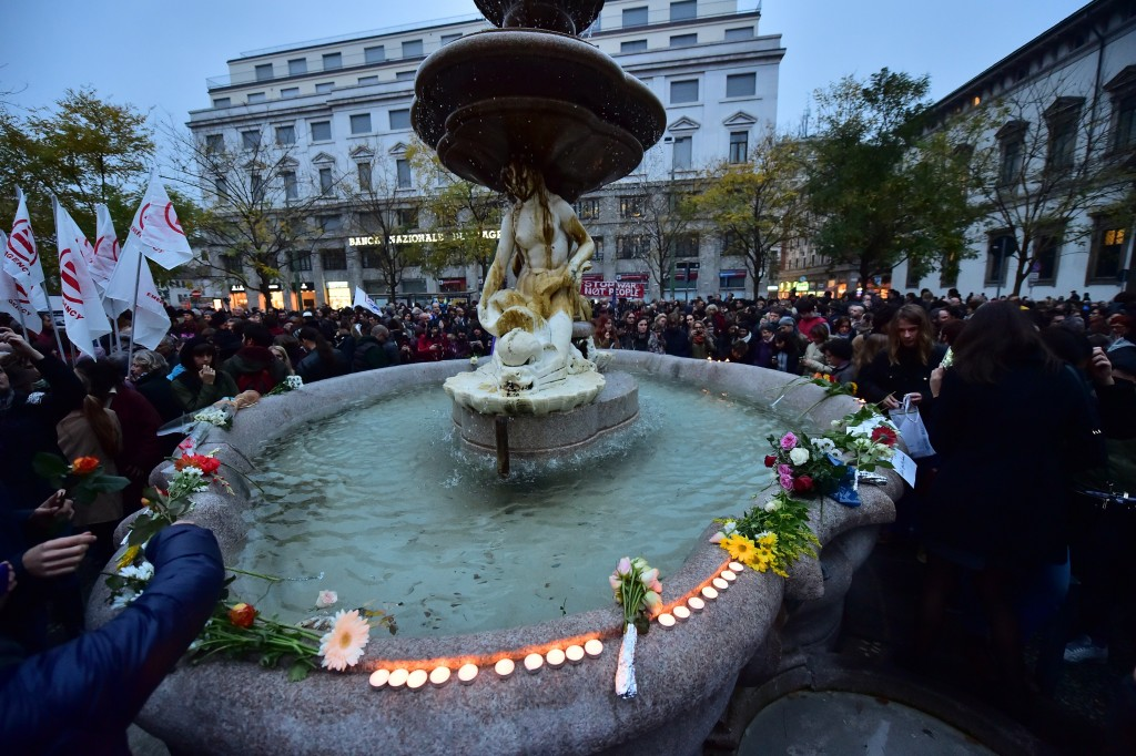 People gather  in Piazza Fontana in Milan on November 14, 2015, a day after deadly attacks in Paris. Photo by Giuseppe Cacace/AFP/Getty Images