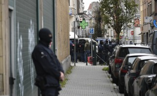Police officers stand guard as an operation takes place in the Molenbeek district of Brussels on November 16, 2015. Belgian police launched a major new operation in the Brussels district of Molenbeek, where several suspects in the Paris attacks had previously lived, AFP journalists said. Armed police stood in front of a police van blocking a street in the run-down area of the capital while Belgian media said officers had surrounded a house. Belgian prosecutors had no immediate comment. AFP PHOTO / JOHN THYS        (Photo credit should read JOHN THYS/AFP/Getty Images)