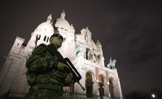 A French soldier enforcing the Vigipirate plan, France's national security alert system, patrols in front of the Sacre Coeur Basilica on November 16, 2015 in Paris, three days after a series of deadly coordinated attacks claimed by Islamic State jihadists, which killed at least 129 people and left more than 350 injured on November 13. AFP PHOTO/JOEL SAGET        (Photo credit should read JOEL SAGET/AFP/Getty Images)