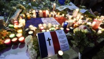 "View of candles and flowers outside the French embassy building in Mexico City on November 16, 2015, in solidarity with the victims of Paris' attacks. A total of 129 people died and 352 were injured in the November 13 attacks in Paris in what for now is only ""a temporary"" toll, Paris prosecutor said. AFP PHOTO / ALFREDO ESTRELLA        (Photo credit should read ALFREDO ESTRELLA/AFP/Getty Images)"