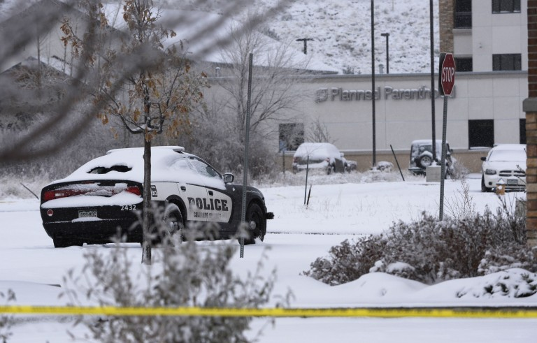 COLORADO SPRINGS,CO -  November 28: A Colorado Springs police car sits in a parking lot next to a Chase bank with it's back window shot out on site of a shooting near the Colorado Planned Parenthood clinic November 28, 2015. The shooter,  identified by authorities as Robert Lewis Dear, shot and killed a University of Colorado Colorado Springs police officer Garrett Swasey and two other people Friday November 27, 2015. Several others were injured during the shootout including several Colorado Springs police officers. Photo by Andy Cross/The Denver Post via Getty Images