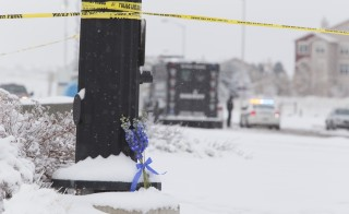 Flowers lay at the police line at the scene outside the Planned Parenthood building in Colorado Springs, CO on Saturday, November 28, 2015.