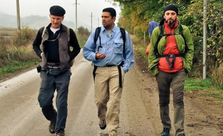 Flanked by Paul Salopek, left, and his Georgian walking guide Dima Bit-Suleiman. Photo by Morgan Till