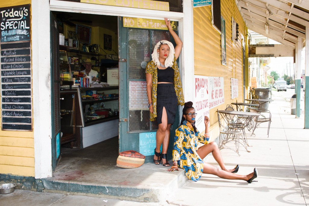 Two women wait outside Frady's One Stop Food Store in New Orleans, LA. Photo by Danielle Miles