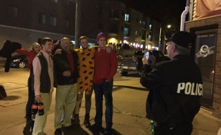 Iowa State University President Steven Leath poses for a photo with students during a recent late-night patrol of neighborhoods popular with partying students. Photo by Kellie Woodhouse/Inside Higher Ed.