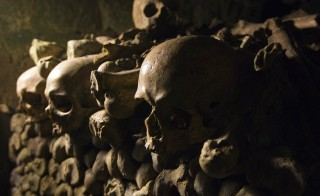 Detail of human skulls and bones which are stacked in the ossuary room in the catacombs of Paris June 24, 2011. The ossuary holds the remains of about 6 million people in caverns and tunnels that are the remains of Paris' stone quarries.   REUTERS/Charles Platiau  (FRANCE - Tags: CITYSCAPE ODDLY) - RTR2O6WS