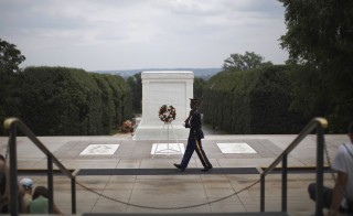 A Sentinel of the U.S. Army Old Guard marches past the Tomb of the Unknown Soldier at Arlington National Cemetery June 25, 2011. On this day, Paula Davis, mother of fallen U.S. Army Private Justin Ray Davis, 19, paid a tribute to him on the fifth anniversary of his death in Afghanistan. Paula Davis lost Justin while he fought in Afghanistan in 2006. He had vowed to his mom he'd never forget his childhood memories of September 11 and enlisted in the U.S. Army one week after graduating from high school. Picture taken June 25, 2011. Photo by Jason Reed/Reuters