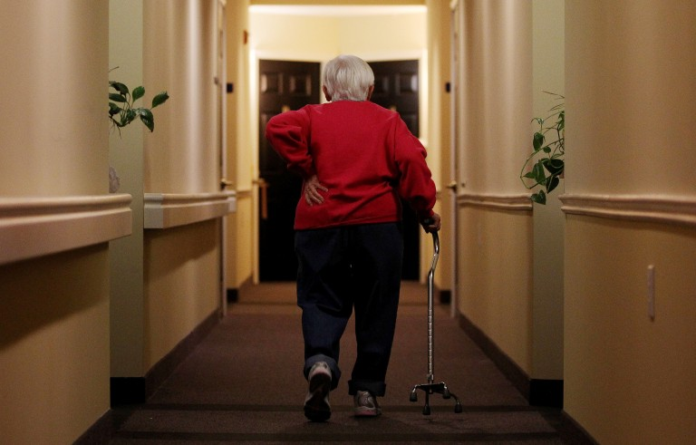 Inez Willis, a senior citizen, walks down the hallway with the aide of a cane to visit a neighbor at her independent living complex in Silver Spring, Maryland April 11, 2012. REUTERS/Gary Cameron   (UNITED STATES - Tags: SOCIETY HEALTH) - RTR30N4P Related words: Medicare , meds, drugs, pills