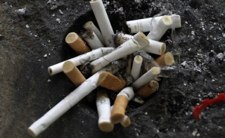 Cigarette butts in an ashtray in Los Angeles, California. The Department of Housing and Urban Development proposed a rule Thursday that would ban smoking in more than 3,100 public housing agencies in the country. Photo Jonathan Alcorn/Reuters