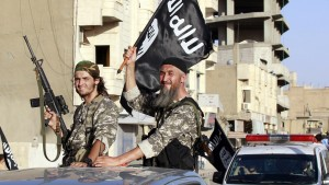 "Militant Islamist fighters wave flags as they take part in a military parade along the streets of Syria's northern Raqqa province June 30, 2014. The fighters held the parade to celebrate their declaration of an Islamic ""caliphate"" after the group captured territory in neighbouring Iraq, a monitoring service said. The Islamic State, an al Qaeda offshoot previously known as Islamic State in Iraq and the Levant (ISIL), posted pictures online on Sunday of people waving black flags from cars and holding guns in the air, the SITE monitoring service said. Picture taken June 30, 2014.  REUTERS/Stringer (SYRIA - Tags: POLITICS CIVIL UNREST CONFLICT) - RTR3WKNM"