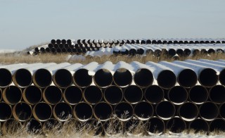 A depot used to store pipes for Transcanada Corp's planned Keystone XL oil pipeline is seen in Gascoyne, North Dakota November 14, 2014. The Republican-led U.S. House of Representatives approved the Keystone XL pipeline on Friday, but a similar measure struggled to get enough support in the Senate and President Barack Obama indicated he might use his veto if the bill does get through Congress. REUTERS/Andrew Cullen   (UNITED STATES - Tags: ENERGY BUSINESS) - RTR4E83W