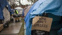 A sign on a tent is seen at Tent City 3, a homeless encampment in Seattle, Washington January 15, 2015. Seattle Mayor Ed Murray will submit legislation to the City Council this week seeking approval of three new homeless encampments, saying the tent cities are needed to deal with rising homelessness, his office said on Thursday.   REUTERS/David Ryder   (UNITED STATES - Tags: SOCIETY POVERTY POLITICS) - RTR4LLYW