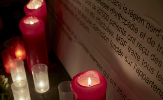 Candles are pictured outside the Medecins Sans Frontieres (MSF) headquarters in Geneva, Switzerland October 7, 2015. The U.S. military took responsibility on Tuesday for a deadly air strike on a hospital in the Afghan city of Kunduz, calling it a mistake and vowing to hold people accountable. Saturday's strike on the Afghan hospital run by Doctors Without Borders, or Medecins Sans Frontieres (MSF), killed 22 people and deeply angered the medical charity. MSF officials have blamed the United States, demanding an independent investigation into an attack it called a war crime.    REUTERS/Denis Balibouse - RTS3C65