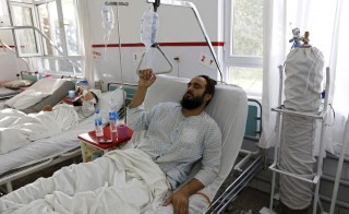 A wounded Afghan man, who survived a U.S. air strike on a Medecins Sans Frontieres (MSF) hospital in Kunduz, Afghanistan, receives treatment at the Emergency Hospital in Kabul on Oct. 8, 2015. Photo by Mohammad Ismail/Reuters