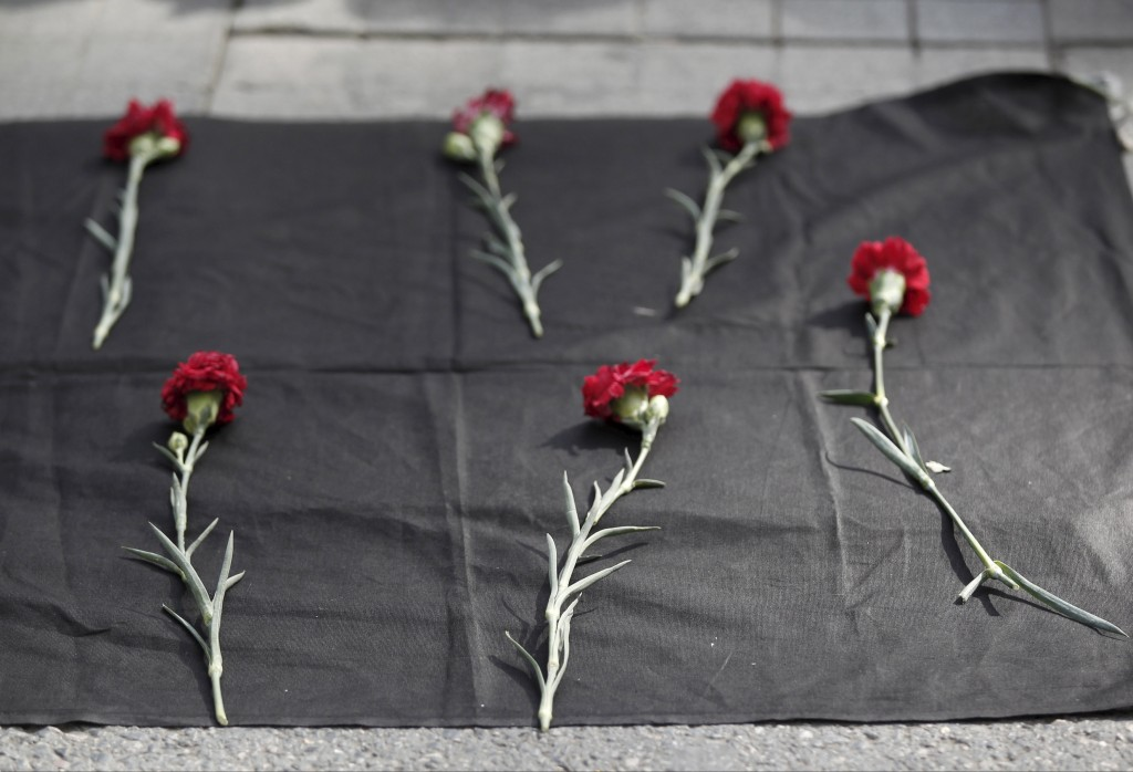 Carnations are seen placed on the ground during a protest against explosions at a peace march in Ankara, in central Istanbul, Turkey, October 10, 2015. At least 30 people were killed when twin explosions hit a rally of hundreds of pro-Kurdish and leftist activists outside Ankara's main train station on Saturday in what the government described as a terrorist attack, weeks ahead of an election. REUTERS/Osman Orsal