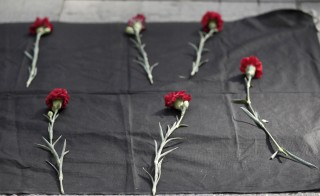 Carnations are seen placed on the ground during a protest against explosions at a peace march in Ankara, in central Istanbul, Turkey, October 10, 2015. At least 30 people were killed when twin explosions hit a rally of hundreds of pro-Kurdish and leftist activists outside Ankara's main train station on Saturday in what the government described as a terrorist attack, weeks ahead of an election. REUTERS/Osman Orsal - RTS3UKE
