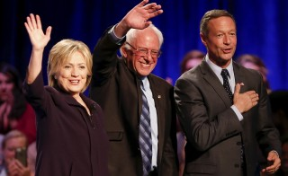 Democratic presidential candidates Hillary Clinton (L), Bernie Sanders (C) and Martin O'Malley (R) wave to the crowd following the First in the South Presidential Candidates Forum held at Winthrop University in Rock Hill, South Carolina November 6, 2015. REUTERS/Chris Keane      TPX IMAGES OF THE DAY      - RTS5VW2